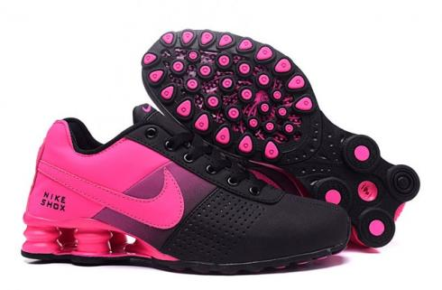 pink and black nikes shoes